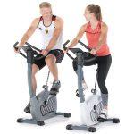 Olympiasieger Max Rendschmidt und Leichtathletin Gina Lückenkemper beim Training mit dem Ergometer Wiry